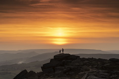 Stone in my shoe.... (Waving lights in the dark) Tags: sunset stanage edge stanageedge peakdistrict peak derbyshire landscape nightphotography nightlandscape orange hue hills peaks silhouette pose convenient climb lodged shoe chivalry romantic dust evening sun rocks couple