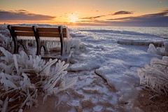 Slippery sunset (ericstadler83) Tags: best professional pro interesting snow winter resolution high world your explore colors color saturation filter polarizer landscape grass subtle fantastic fave favorite gorgeous beautiful beach ludington hour golden sunset pure michigan lake water ice bench sel70200g zeiss iii a7r a7riii a7r3 sony