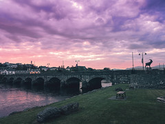 Scenic view of bridge and Sunset over the Killorglin.. (krpena.lutkica) Tags: stone bridge rocks walk sunset pink clouds town houses traditional tourism visiting nature statue puck fair