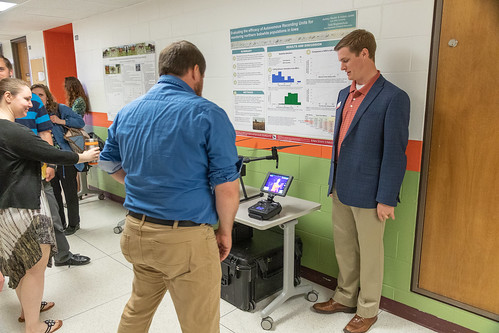 Prof. Adam Janke shows off research toys--audio recorder and drone with thermal imager