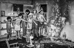 """Point the light where the fire started."" (FotoGrazio) Tags: firedamage teenagers hilarious people fotograzio photojournalism burnt burmuda fan children damage brothers charred waynesgrazio housefire waynestevengrazio burn waynegrazio funny blackandwhite forensic monochrome kids pointing fire boys cutoffshorts"