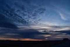 Along the road 2 (darletts56) Tags: sky blue cloud clouds grey white yellow orange black silhouette field fields road roads highway sun sunset dusk evening night tree trees prairie spring saskatchewan canada