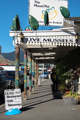 Live Mussels (Jocey K) Tags: marlboroughsounds newzealand southisland marlborough havelock road street cars signs cafe sky hills plants shadows artwork buildings architecture
