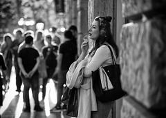 (graveur8x) Tags: woman candid street potrait smoking frankfurt germany deutschland blackandwhite smoke cigarette sun contrast light city frau streetphotography people outside outdoor stadt toughts sony sonya7iii zeissbatis28135 135mm f28 batis