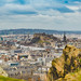 General view of Edinburgh from Edinburgh Castle with Holyrood Park and Arthur`s Seat. Editorial Stock Photo