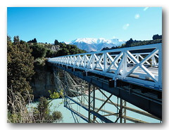 The Rakaia Gorge Bridge. (natureflower photography) Tags: rakaia gorge bridge rakaiariver windwhistle canterbury new zealand south island state highway77 inland scenic route white mthutt selwyn district cholmondeley leading lines structure trees snow sunny day blue skies