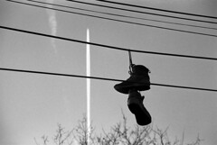 img 9 (popa_sebastianmihail) Tags: street wire sneakers laces youth concept cable outdoors tangle sky shoelaces silhouette background pair urban line shoes dangling funny abandoned retro black footwear hanging city film ilford ishootfilm filmisnotdead panf iso50 outdoor canon eos1 bucharest romania
