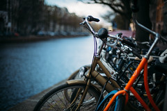 Amsterdam bikes.. (paul.wienerroither) Tags: amsterdam holland dutch netherlands travel weekendtrip trip photography canon 5dmarkiii 50mm niftyfifty city streets street streetphotography bikes bike dof depthoffield bokeh light afternoon spring europe water canal colors colours