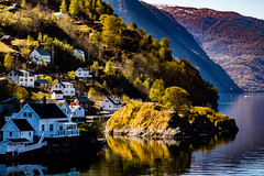 In the Fjord (langdon10) Tags: countryside mountains norway water calm fishingvillage fjord houses reflections rock shoreline