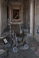 Wheelchair and Hallway (rantropolis) Tags: abandoned hospital wheelchair hallway peeling wall asylum urbex urban exploration nikon d750 dc general washington 50mm