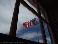 Flag through the Window (Annes Travels) Tags: mounttrumbullschoolhouse arizona historical historic history arizonastrip schoolhouse window flag sky clouds