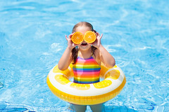 Child in swimming pool. Kid eating orange. (Zutila, Inc.) Tags: pool swimming child summer water kids inflatable girl ring orange fruit vacation family tropical beach outdoor playing fun baby toy holiday island hotel float swim wear swimsuit kid toddler splash play learn sunny children people sun little floating preschooler sport happiness glasses sunglasses exotic goggles asia yellow vitamin healthy snack malaysia