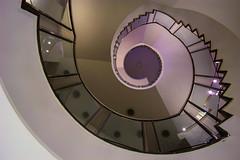 (Elbmaedchen) Tags: staircase stairwell stairs stufen steps treppenauge treppenstufen treppenhaus escalier roundandround interior upanddownstairs helix spirale spiral architektur architecture beauty abwärts geländer gläsernd zackig violett