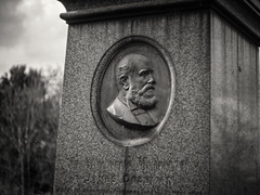 20190304-0534-Edit (www.cjo.info) Tags: 1830s 1836 19thcentury bw england europe europeanunion lambeth london m43 magnificent7 magnificentseven magnificentsevengardencemeteries microfourthirds nikcollection olympus olympuspenfgzuikoautos40mmf14 olympuspenf penfmount silverefexpro silverefexpro2 southmetropolitancemetery unitedkingdom westnorwood westnorwoodcemetery westerneurope beard blackwhite blackandwhite carving cemetery decay digital face facialhair flora gravegraveyard head lettering male man manualfocus monochrome overgrown people plant stone stonework