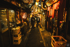 A Narrow Alley (Through the Glass Studios) Tags: photography photo sony sonyalpha sonya7 sonya7ii adobe adobephotoshop adobelightroom photoshop lightroom vsco vscofilm japan travel street streetphotography streetphoto alley alleys restaurant restaurants food dining streetfood person persons people night nighttime evening