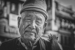 """Don't fritter away your life"" (andy_8357) Tags: boudhanath nepal great stupa tibetan buddhist lama monk man hat stern powerful serious kind sony a6000 mirrorless ilcenex 6000 emount monochrome bw black white blanco y negro blanc et noir sigma 60mm f28 dn art prime kathmandu kora mala strong sunny evening alpha outdoors portrait portraiture natural light street photography tibet"