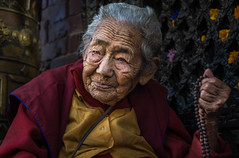 seeing beyond (andy_8357) Tags: old tibetan nun boudhanath nepal great stupa buddhist maroon robes kathmandu seeing beyond sony a6000 6000 ilce6000 ilcenex mirrorless alpha sigma 60mm f28 dn art prime face natural light evening kora kind sympathetic strong aged elder portrait portraiture outdoors street photography tibet