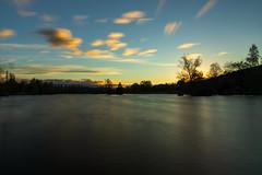 stürmischer Sonnenuntergang (Giuseppe Caponio) Tags: abendrot bäume frühling landschaft langzeitbelichtung ndfilter see sonne sonnenuntergang wasser wind wolken oberuzwil kantonstgallen schweiz
