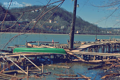 Green Canoe (Hi-Fi Fotos) Tags: green canoe boat dock wood mess shambles wreck broken blight sad pittsburgh 50mm nikon d5000 dx hififotos hallewell allegheny river water