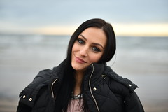 Anna V. (Pavels Dunaicevs) Tags: girl woman female cute nice beautiful pretty young latvia jurmala smile sea water bokeh nikon nikkor d750 50mm 14 portrait winter jacket smiling beach cloudy afternoon happy charming evening black hair contrast makeup lovely