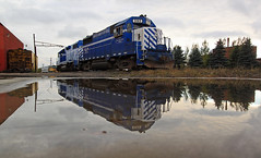 Calm comes over the 35 (GLC 392) Tags: emd gp35 gp382 glc great lakes central 399 392 reflection water cloud clouds cloudy railroad railway train double vision cadillac mi michigan