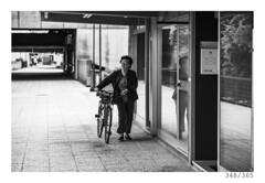 Going home (Aljaž Anžič Tuna) Tags: elder lady old oldlady bicycle nova gorica street streetphotography photo365 project365 portrait onephotoaday onceaday 3 365 35mm 365challenge 365project nikkor nice nikond800 naturallight nikon nikon105mmf28 105mmf28 f28 female dailyphoto day d800 bw blackandwhite black white blackwhite beautiful