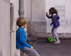 Want to play (N.Hell) Tags: children boy girl stranger streetphotography play football ball sigma 105mm portrait bokeh waiting sit looking street people