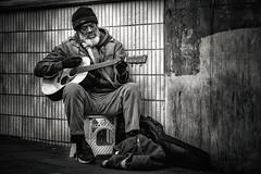 Guitar Player (Dannis van der Heiden) Tags: guitar man stool wall bag guitarplayer guitarcover tiles gloves camden camdentown music cap london england uk nikond750 d750 tamron70210mmf4 blackandwhite blackwhite monochrome streetportrait portrait sidewalk persona street streetphotography streetmusician performer