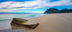 alone on the beach (Nosetan) Tags: blue beach black big stone sea sky sun alone away water natur landscape nature dark way norway end wind