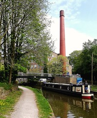 Clarence Mill - Bollington and 'Chongololo' (Gerry Hat Trick) Tags: wednesdaywalk macclesfield canal bollington cheshire walking walk hiking hike wednesdaywalkers towpath clarence mill waterside cafe boat narrow bridge footbridge chimney chongololo barge huaweip20lite mobilephonepic middlewoodway poynton adlington