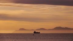 Dawn Flight - II (endresárvári) Tags: mallorca sea canon sunrise orange ship baleares alcudia mediterranean mediterraneansea vapor water cloud clouds mountain dawn summer