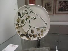 Plate with painted goat's head,  Picasso  Museum,  Buitrago  de Lozoya, Madrid (d.kevan) Tags: museum buitragodelozoya exhibits ceramics drawings displaycabinets madrid spain goatshead plates