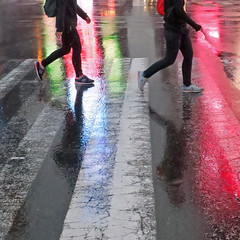 synchronized (Jim_ATL) Tags: two pedestrians night rain street crossing red green neon reflection timessquare newyork bsquarecontestentry
