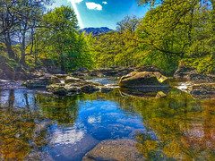 The River Falloch shimmering in the summer sunshine. (peterileypics) Tags: scotland lochlomond river riverfalloch loch reflection light sky clouds summer lightroom