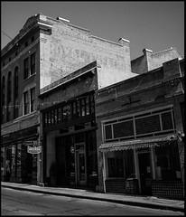 Faded Ghost Sign (greenschist) Tags: usa stores cochisecounty film analog ghostsign blackwhite arizona bronicarf645 kodakektar100 zenzanonrf65mmf4 bisbee