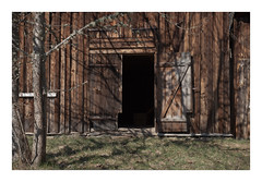 LW XXI ([ Time - Beacon ]) Tags: tb barn texture doorway wooden old building decay rural doors lines shadowplay sweden weathered