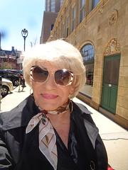 It's A Bright, Bright Sunny Sunday On The Streets Of Milwaukee (Laurette Victoria) Tags: sidewalk milwaukee woman laurette blonde kerchief sunglasses