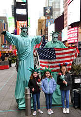 Welcome To New York! (Anthony Mark Images) Tags: statuesofliberty ladyliberty littlegirls sisters tourists timessquare newyork nyc manhattan americanflags torches people portrait cute libertyhats sunglasses smiles excited nikon d850 flickrclickx sweet adorable twins