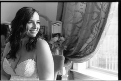 LisaJason10.13.18_071 (Johnny Martyr) Tags: bw black white film 35mm wedding bride bridal prebridal smile window light composition profile hair makeup gown marriage boutique look see happy she her woman dress natural kodak trix hc110b hc110 curtain room teeth eyes face cheeks