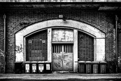 Bin Day (Mister G.C.) Tags: blackandwhite bw image streetshot streetphotography photograph monochrome urban town city arch arches railway brickwork rubbishbins garbage textures gritty architecture graffiti door doorway sonya6000 sonyalpha a6000 mirrorless telephoto zoom lens sel18105 18105mm sonyglens sony18105mmepz f4 mistergc schwarzweiss strassenfotografie berlin deutschland europe