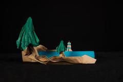 Between Earth and Sea (Djangorigami) Tags: bellecombeenbauges savoie france origami pliage art plieur folder sculpture paysage landscape blue green pine tree lighthouse phare mer terre earth sea photo shape