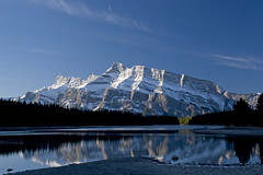 Mountain Reflection (Daniel0556) Tags: mountain lake still calm early morning sunrise reflecting trees pine forest snow covered green water rock shore clear blue sky sunny banff national park canada alberta fall season