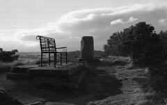 Clifftop bench near Stirling Castle, Stirling, Scotland (AJH_1) Tags: olympus om1 kodak tmax 400iso 35mm 50mm lens scotland stirling caste uk landscape view black white monochrome bw bench