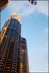 Petronas Tower 1 (G. Postlethwaite esq.) Tags: borneo fujx100t kl kualalumpur malaysia petronastowers singapore southeastasia unlimitedphotos clouds dusk photoborder sky