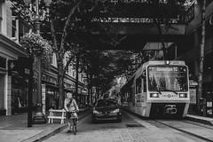 (el zopilote) Tags: portland oregon people street cityscape architecture signs wheels bikes cars trains powerlines lumix gf1 milc m43 lumixgvario1442mmf3556asphmegaois bw bn nb blancoynegro blackwhite noiretblanc digitalbw bndigital schwarzweiss monochrome 500 gente