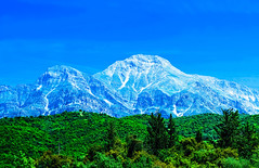 Dominating the Landscape (GEORGE TSIMTSIMIS) Tags: landscape mountain spring greece achaia pentaxk1 colours blue geen sky trees nature fullframe ricoh imaging outdoorphotography pentaxhddfa2470mmf28edsdmwr erimanthos olenos ricohimaging pentaxsmc country explore snow stiffcliff