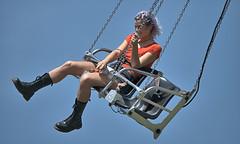 Lone Rider (Scott 97006) Tags: woman femalelady blonde ride sky alone carnival fun amusement entertainment