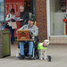 Mell Square, Solihull - street entertainer and his guide dog