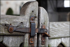 Lych gate latch (G. Postlethwaite esq.) Tags: boylestone dof derbyshire macro stmichaelschurch suttononthehill unlimitedphotos bokeh closeup depthoffield latch lychgate photoborder selectivefocus