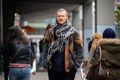(graveur8x) Tags: man candid street potrait frankfurt germany deutschland dof mann streetphotography urban people outside outdoor city stadt zeil main hessen scarf look blueeyes sony sonya7iii zeissbatis28135 135mm batis